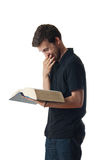 Man reading from a large book and laughing Stock Photography