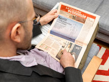 Man reading Le Figaro Economie French newspaper about prices of Royalty Free Stock Image