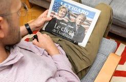 Man reading Le Figaro magazine Hillary Clinton and Donald Trump Royalty Free Stock Photo