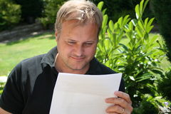 Man reading letter Stock Photo