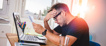 Man reading letter and felling worried Stock Images