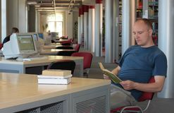 Man reading in the library. A man reading in the library stock image