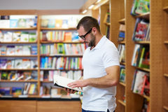 Man reading in the library Stock Photos