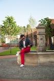 Man reading a magazine near the fountain. Royalty Free Stock Photos