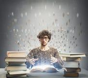 Man reading a magical book royalty free stock photos