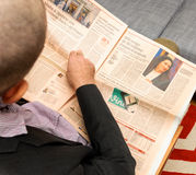 Man reading about Marks & Spencer problems in France Royalty Free Stock Photography