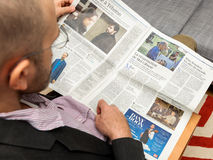 Man reading about Mel Gibson ressurection in Le Figaro Royalty Free Stock Photography