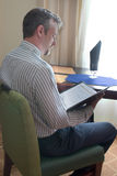 Man reading menu Stock Image