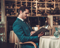 Man reading menu in a restaurant Royalty Free Stock Images