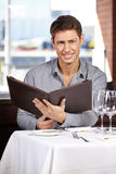 Man reading menu at restaurant Royalty Free Stock Images
