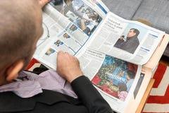 Man reading about Mikheil Saakashvili, exit from Ukraine Stock Photos