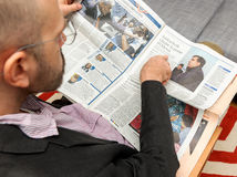 Man reading about Mikheil Saakashvili, exit from Ukraine Royalty Free Stock Photos