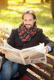 Man reading newpaper in the park Royalty Free Stock Photos
