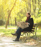 Man reading newpaper in the park Stock Image