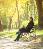 Man reading newpaper in the park Royalty Free Stock Photo