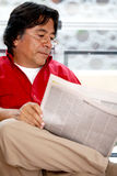 Man reading the news Stock Photo