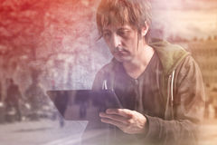 Man Reading News on Digital Tablet Computer Stock Images