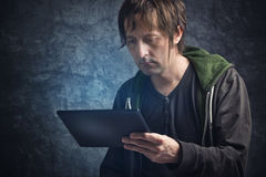 Man Reading News on Digital Tablet Computer Royalty Free Stock Photography