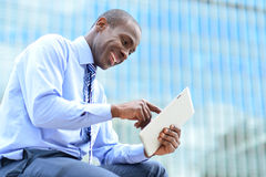 Man reading news on his tablet pc Stock Image