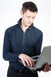Man reading the news on the laptop. Stockbroker trades online. White background Royalty Free Stock Photos