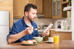 Man reading news over breakfast Royalty Free Stock Image