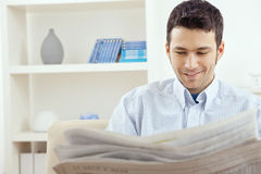 Man reading newspaper Stock Photo