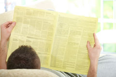 Man reading newspaper Stock Photography