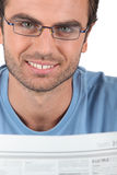 Man reading the newspaper Stock Image