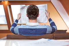 Man reading newspaper Royalty Free Stock Photo