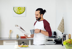 Free Man Reading Newspaper And Eating At Home Kitchen Stock Photos - 88911733