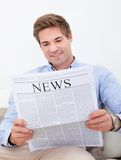 Man Reading Newspaper Stock Photos
