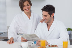 Man reading a newspaper while having breakfast Royalty Free Stock Photography