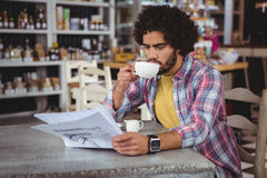 Man reading newspaper while having coffee Royalty Free Stock Photo