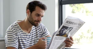 Man is reading newspaper stock footage