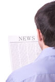 Man reading a newspaper with inscription NEWS Stock Images
