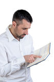 Man reading notebook Royalty Free Stock Images