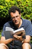 Man reading a novel Stock Photography