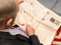 Man reading about nuclear plants in France in newspaper Stock Photography