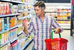 Man reading nutritional values Stock Photos