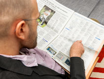 Man reading obituaries in newspaper Stock Photos
