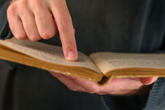 Man reading old book Stock Photography