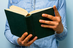 Man reading old heavy book. The Bible? Stock Image