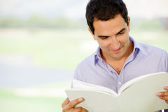 Man reading outdoors Stock Image