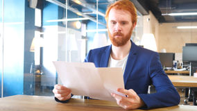 Man Reading Papers in Office. High quality Royalty Free Stock Photography