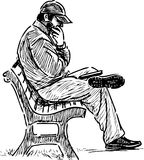 Man reading on a park bench Royalty Free Stock Images