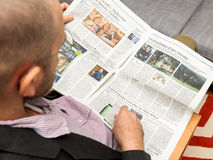 Man reading about pensions and how to stay young Stock Photos