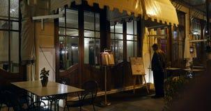 Man reading restaurant menu stock footage