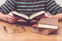 Man reading a some books Stock Image