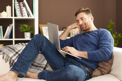 Man reading something on laptop Stock Photography