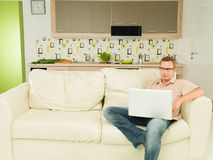 Man reading something on laptop Royalty Free Stock Image